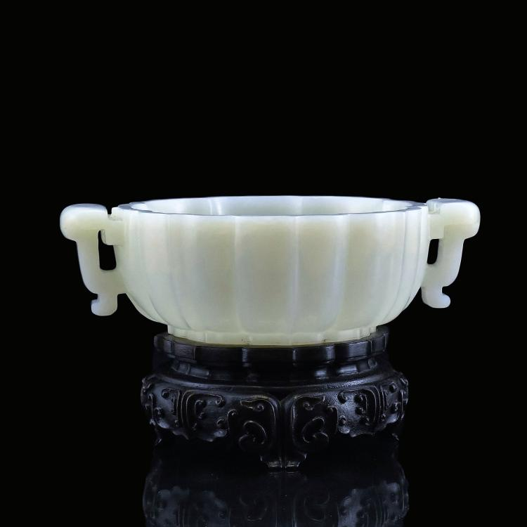 A SUPERB PALE CELADON JADE FLORIFORM MARRIAGE BOWL