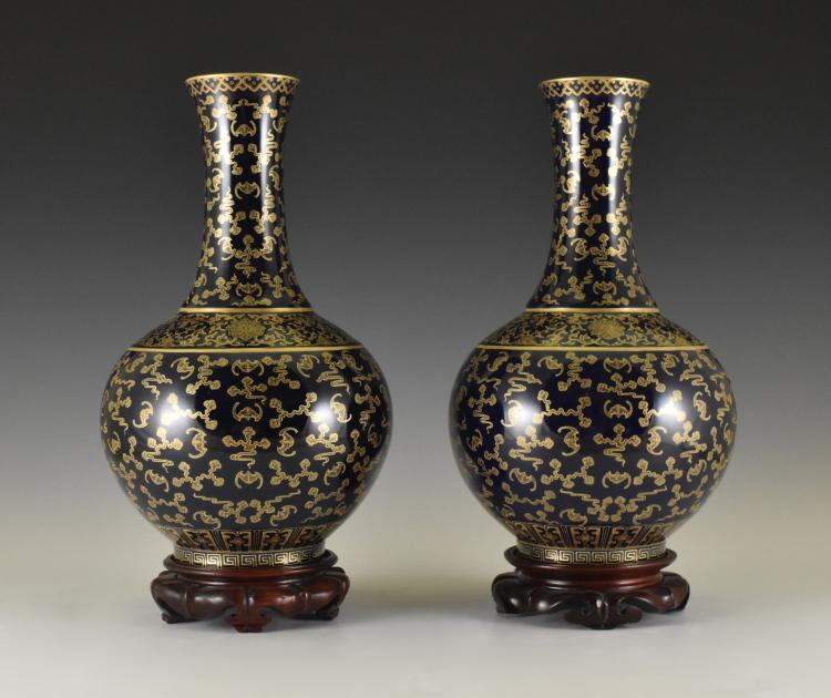 PAIR OF GILT BATS MOTIF ON ROYAL BLUE VASES