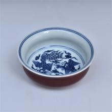 BLUE AND WHITE PHOENIX MOTIF ON RED BOWL