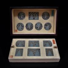 SET OF 13 CARVED JADE MEDALIONS AND PLAQUE IN A BOX