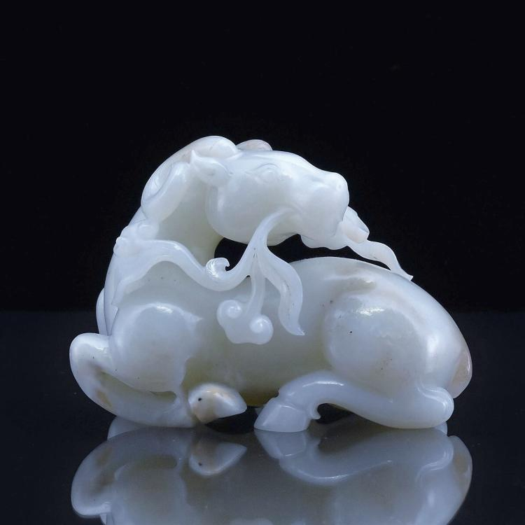 LARGE CARVED WHITE JADE OF A HORSE
