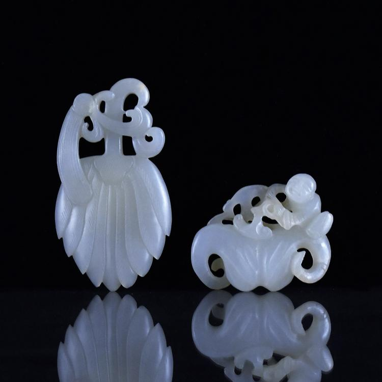 PAIR OF CARVED WHITE JADE PENDANTS