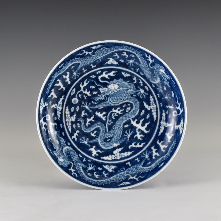 A MOULDED REVERSE-DECORATED 'DRAGON' CHARGER