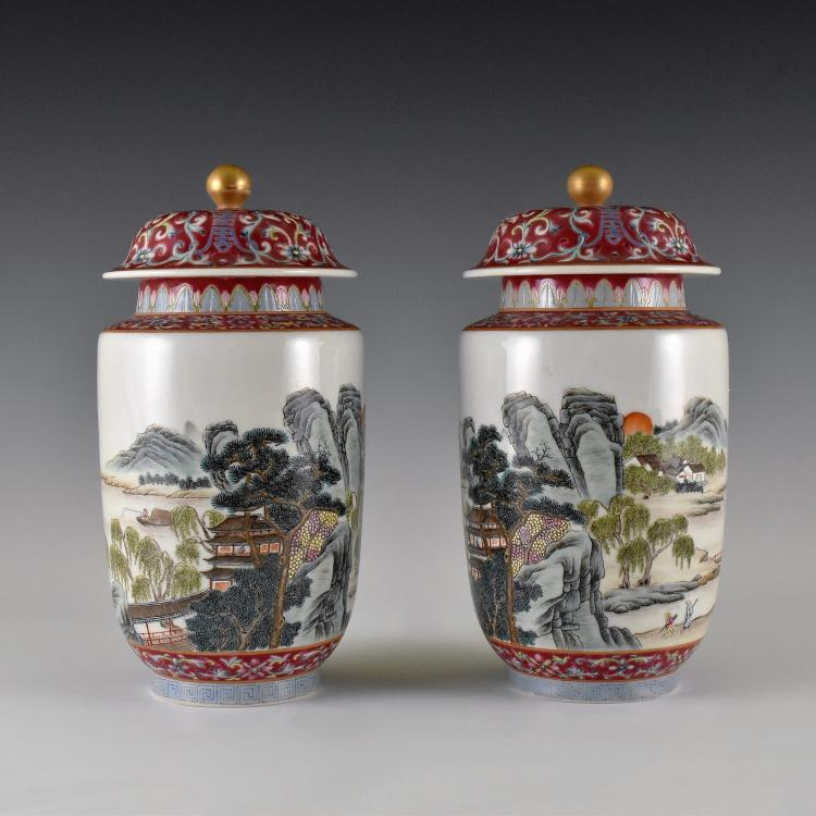 PAIR OF LANDSCAPE MOTIF FAMILLE ROSE LIDDED JARS