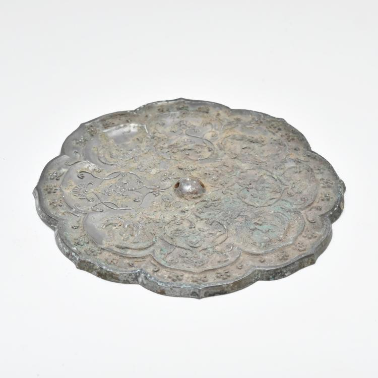 AN ANTIQUE CHINESE BRONZE MIRROR