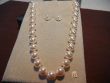 MM Crystal Necklace and Earring Set .925 Electo-Phoretically Plated, 12 Genuine Pearls, and 40 Clear