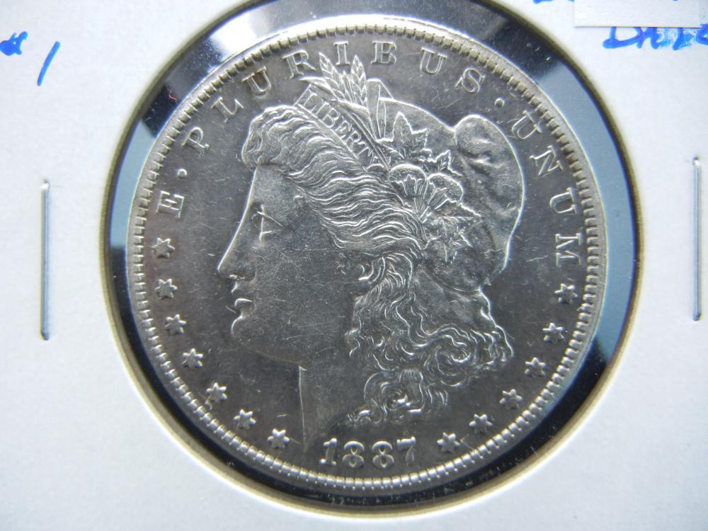 1887-S Morgan $1.  AU/UNC.  Better Date.