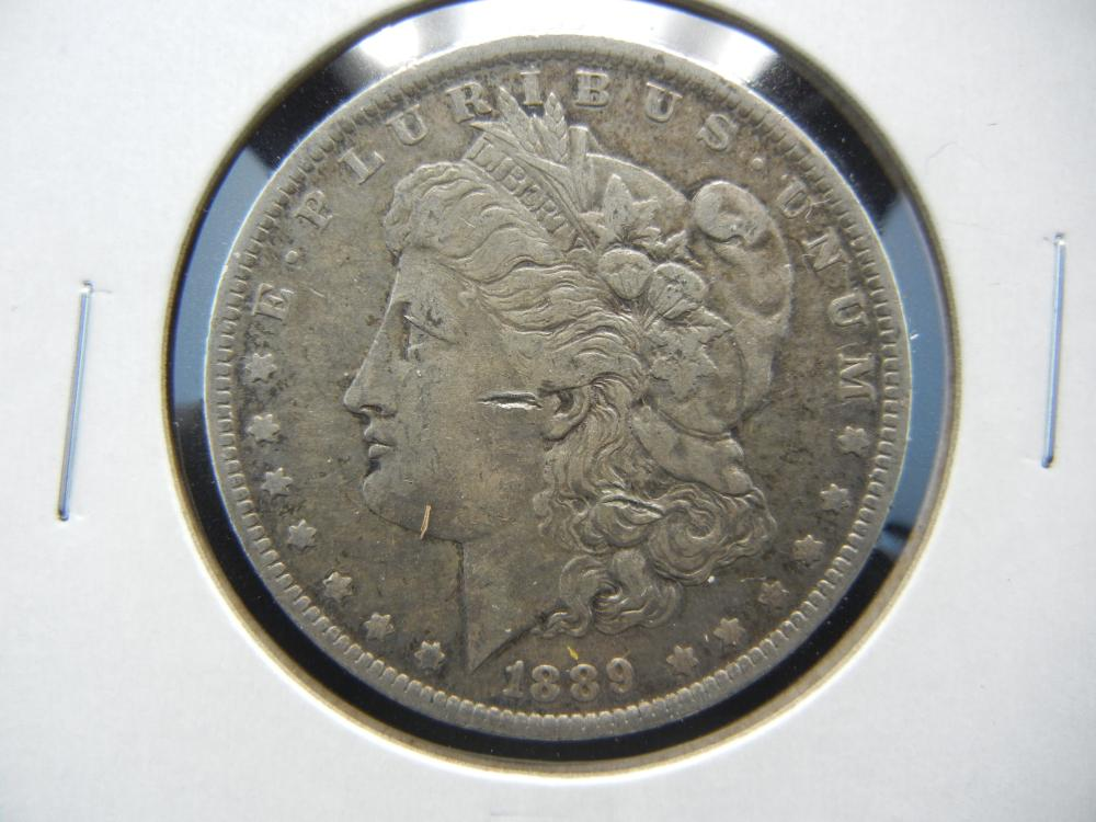 1889-O Morgan One Dollar .
