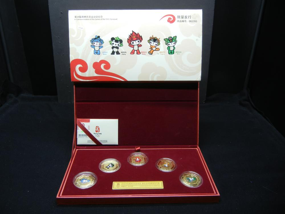 2008 China Olympics Mascot Souvenir Set in original box.   Gold plated.