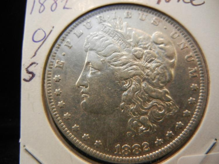 1882 O/S that's right and O over an S Morgan dollar with luster.  Nice.