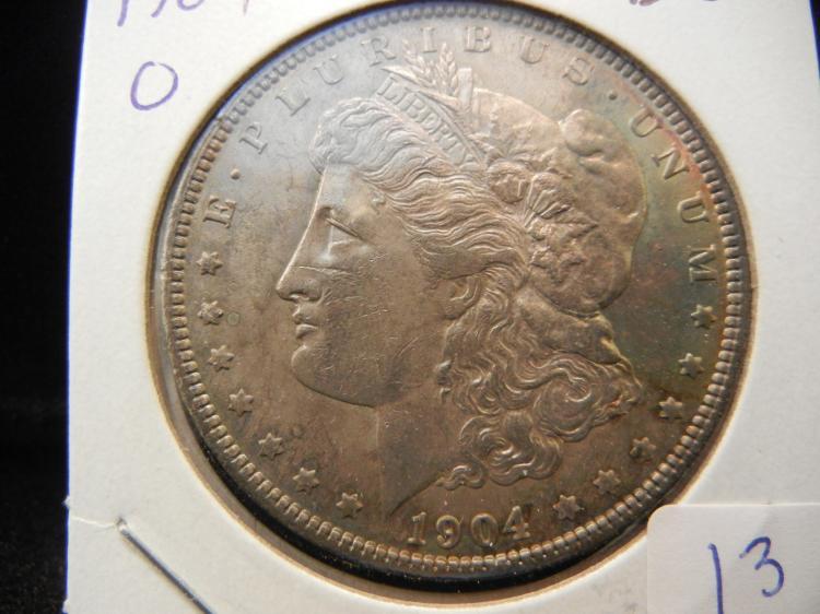1904-O Morgan Dollar. Brilliant Uncirculated. Nice Toning.