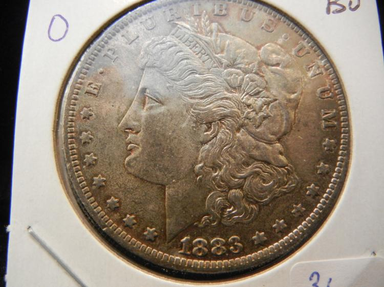 1883-O Morgan Dollar. Choice Brilliant Uncirculated with nice toning.
