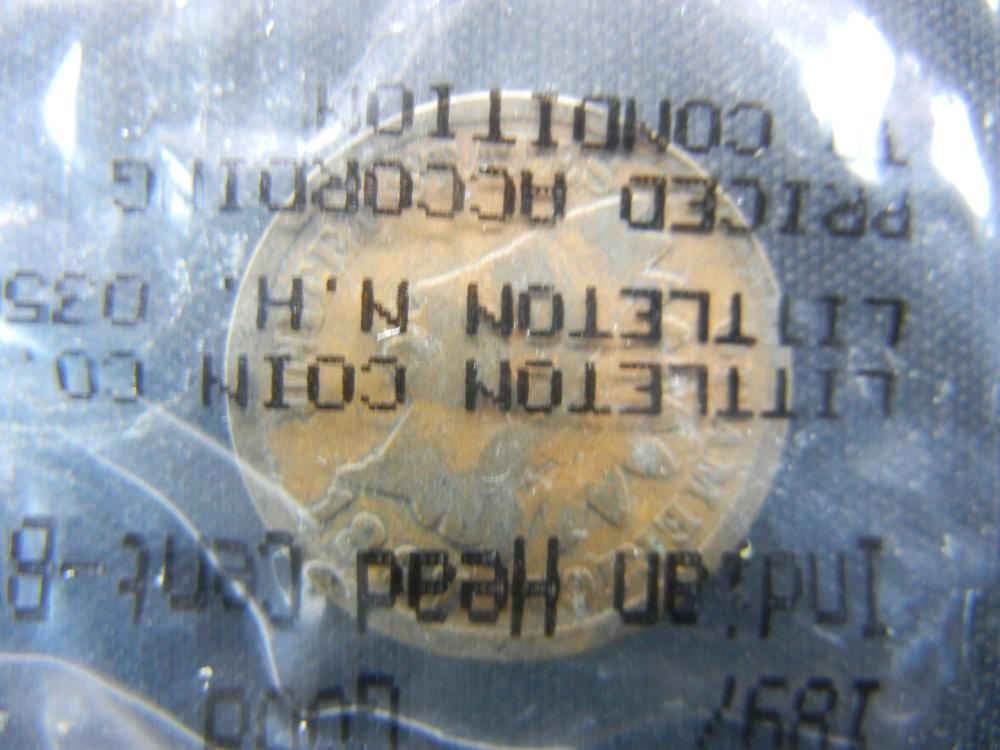 1897 Indian Head Cent Graded Good By Littleton Coin Co. Packaged in Cellophane.