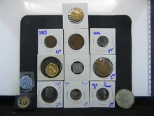 HODGEPODGE COIN LOT INCLUDES MEDAL CELEBRATING THE 75TH ANNIVERSARY OF THE COCA COLA BOTTLING PLANT, 1950 JEFFERSON NICKEL, MINI PLAQUE WITH MERCURY DIME, SERENITY PRAYER MEDAL, ANGEL MEDAL. 2 CENT PIECE, 1984-S PROOF KENNEDY HALF DOLLAR, 1969-S
