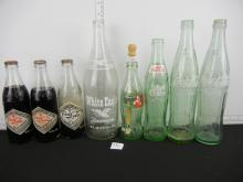 7 Vintage Coca-Cola Glass Bottles (3 Contain Some New Old Stock) and (1) 28 Oz. White Eagle Beverages Glass Bottle (BUYER MUST ARRANGE SHIPPING FOR THIS ITEM)