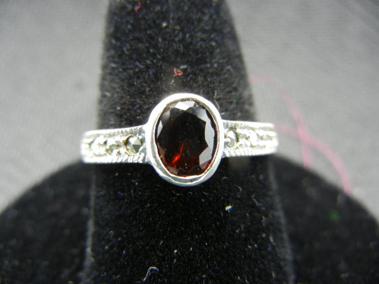 Sterling Silver w/Red Gem Size 8