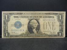 "Lot 29K: 1928-B $1 ""Funny Back"" Silver Certificate. Serial # G65201182B"