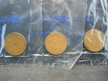 Lot 19N: 1935-P 1935-S 1937-P Lincoln Cents Packaged by Littleton Coin Company in Cellophane.