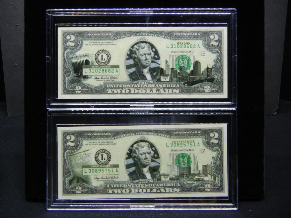 Lot 3: (2) Series 2003A $2 Bills modified to show scenes from Oregon and Connecticut. Neat. Crisp Uncirculated.