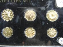 Lot 49C: CLAD SOUVENIR CALIFORNIA GOLD TOKENS, UNCIRCULATED TYPE SET (10 COINS), SEALED IN HARD PLASTIC, CLAD