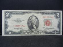 Lot 14A: 1953 A $2 Red Seal. A STAR Replacement Note. Nice VF. Low SN