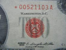 Lot 14: 1953 $2 Red Seal. A STAR Replacement Note. Nice XF. Low SN