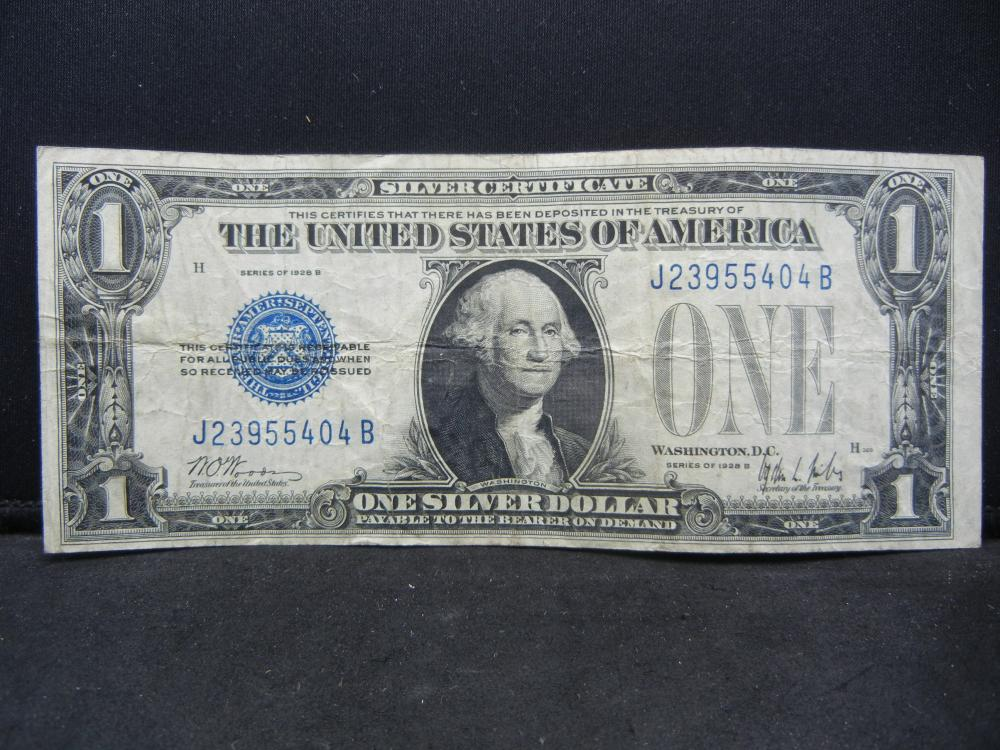 Lot 12A: 1928-B $1 Silver Certificate. Another famous Funny Back. Very Fine.