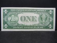 Lot 11A: 1935 E $1 Silver Certificate. STAR Replacement Note. Choice Crisp Unc. Difficult.