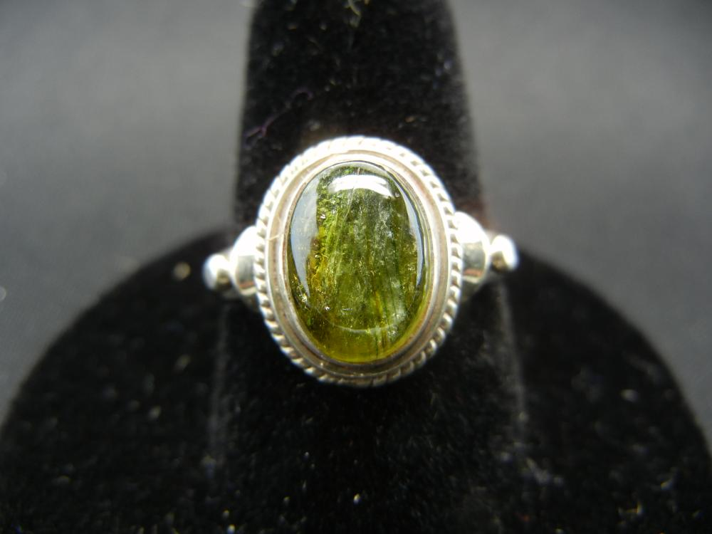 Lot 40: Ladies Sterling Ring with Dark Opal. Size 9.