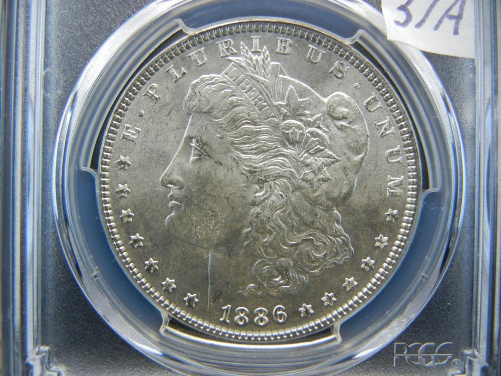 Lot 37A: 1886 Morgan Dollar. PCGS Slabbed MS 65. (They are #1 Grader).