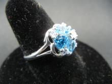 Lot 39A: Ladies Sterling Ring. Aquamarine trillium cut with small cubic zirconia in center. Size 8.