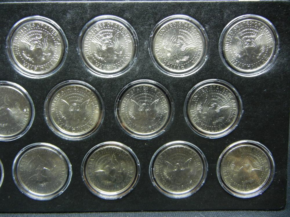 Lot 49: Neat (20) coin P and D Kennedy Half set 2002 through 2011. All Brilliant Uncirculated.
