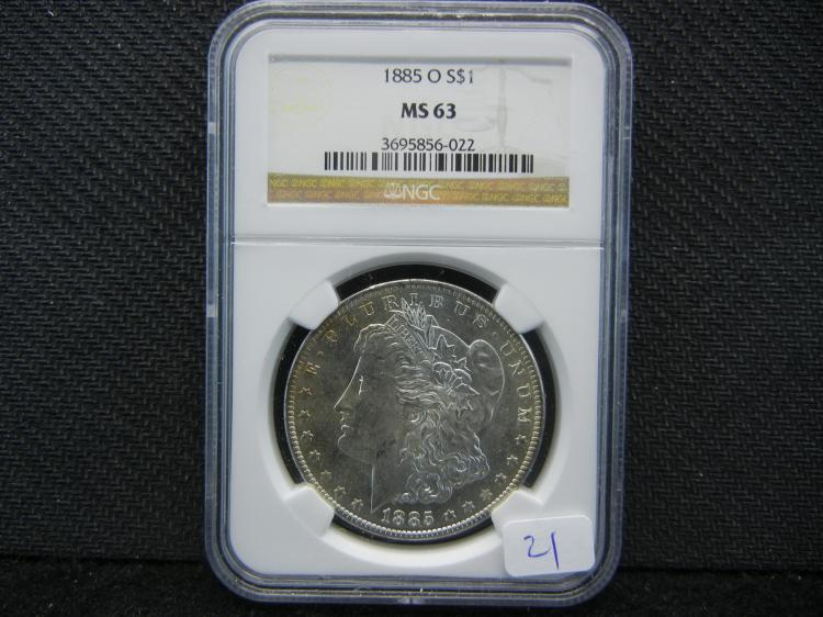 1885-O Morgan Dollar. Graded by PCGS (top graders) as MS63.