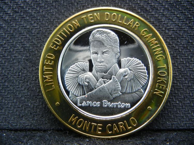 Las Vegas Monte Carlo Lance Burton $10 Gaming Token. 999 silver center. Proof surface.