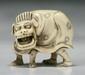A Japanese Antique Carved Ivory Netsuke Shi-shi