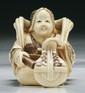A Japanese Antique Carved Ivory Netsuke Lady