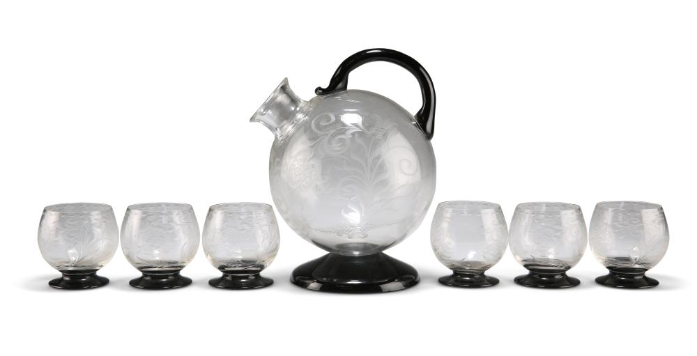 AN ETCHED AND BLACK GLASS DRINKS SET, POSSIBLY ORREFORS,comprising spheric