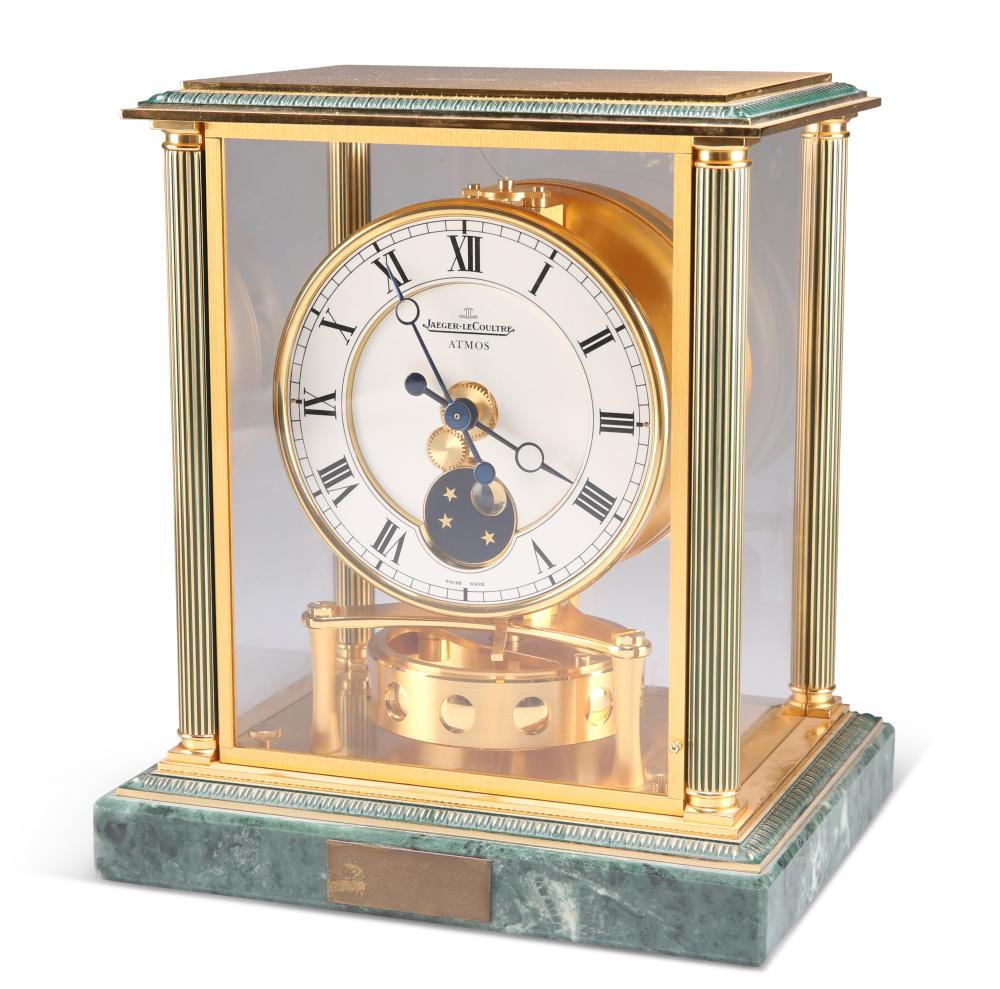 A JAEGER-LECOULTRE ATMOS CLOCK, the case with fluted columns and glazed sid