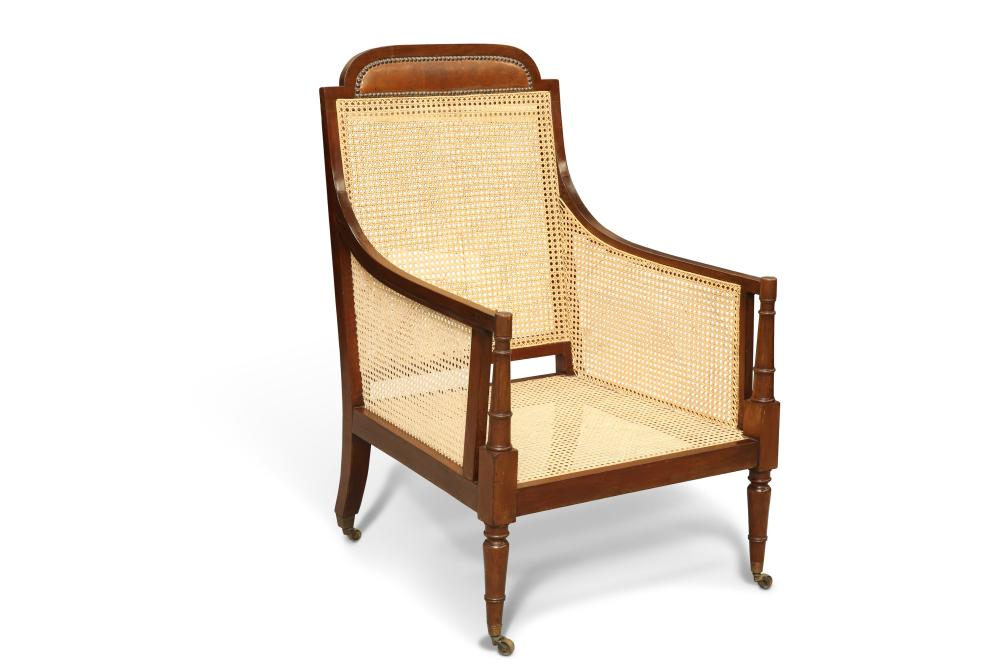 AN EDWARDIAN MAHOGANY AND CANEWORK BERGÈRE, IN GEORGE III STYLE, the crest