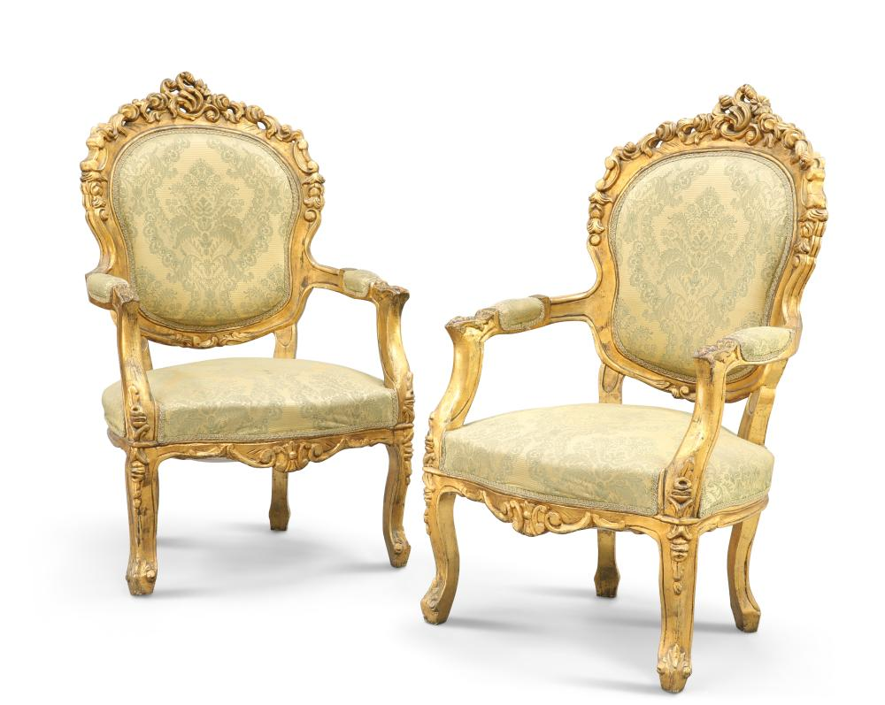 A PAIR OF LOUIS XV STYLE GILDED AND UPHOLSTERED FAUTEUILS, each with pierce