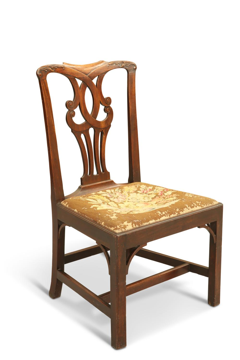 A GEORGE III MAHOGANY SIDECHAIR, 18TH CENTURY, the crest rail carved with l