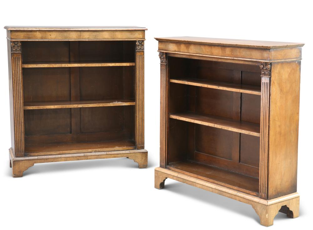 TWO SIMILAR WALNUT OPEN BOOKCASES, in Georgian style, each with two adjusta