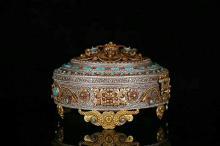 A NEPALESE GILT SILVER TREASURE BOX