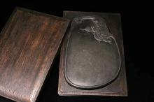 AN OLD RED BOX MUSK DEER INKSTONE, QING DYNASTY