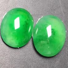 TWO NATURAL JADEITE CABOCHONS