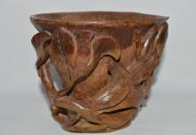 A WOODEN CARVING OF JUE CUP