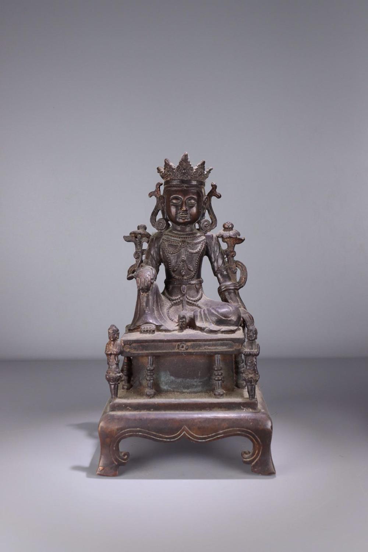 A  'TIBETAN GUANYIN' BUDDHA ON BENCH