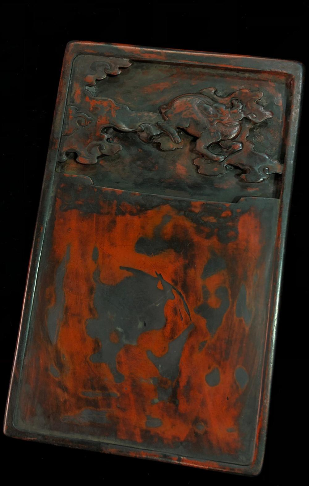 A DUAN STONE AUSPICIOUS DRAGON QILIN & POETRY OF 'WANG HUI' CARVED RED INK SLAB