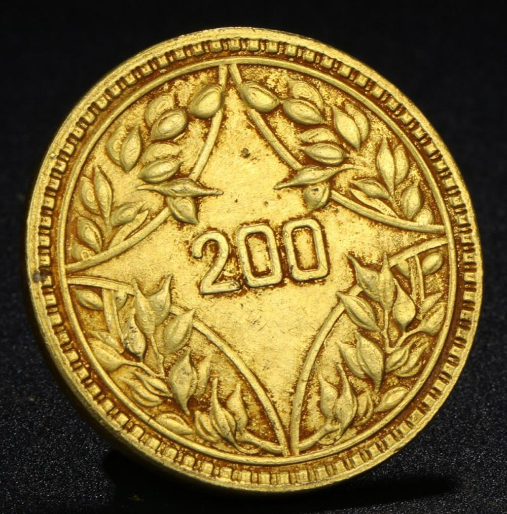 A GILT BRONZE COIN