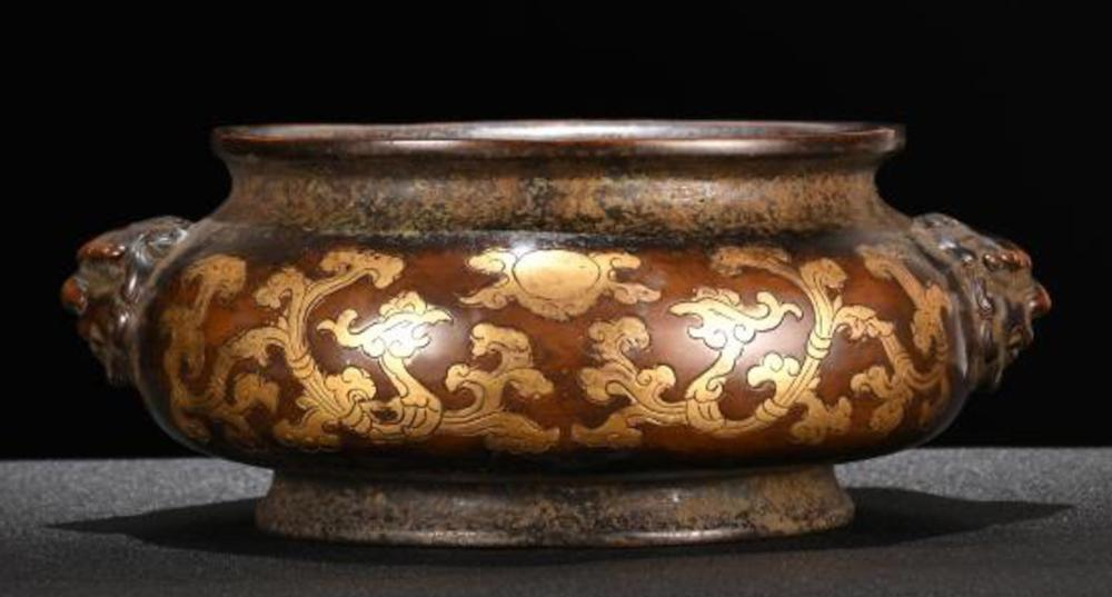 A 'DAMING XUANDE NIANZHI' MARK BRONZE WITH PARTIAL GILT PHOENIX PATTERN & DOUBLE LION EARS CENSER